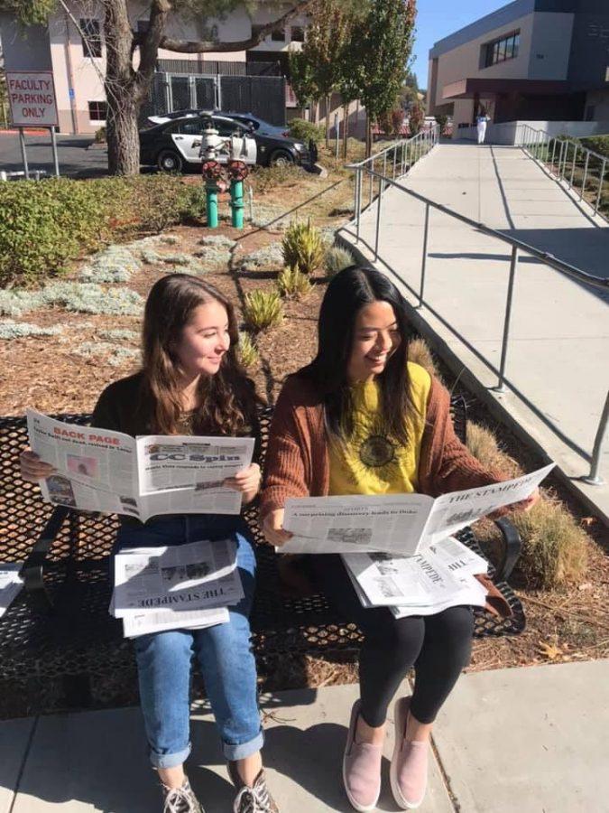 Seniors+look+at+final+magazine
