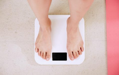 Feet standing on weight scale