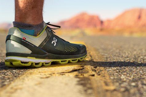 Runners foot, shoe on desert highway