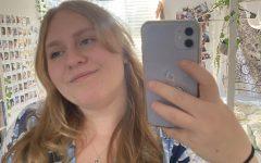 Image in mirror of teen girl