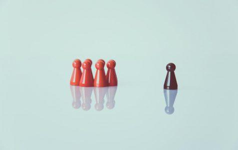 Game pieces representing racial divide