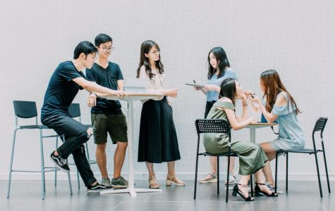Group of six students around desks
