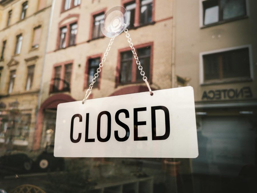 Closed sign in front of building