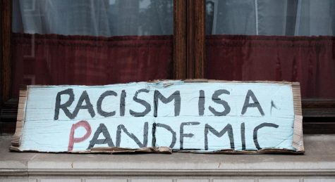 Racism is a pandemic, sign