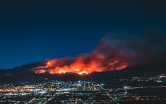 Fires burning on mountainside above city