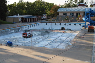 School pool with no water, under construction