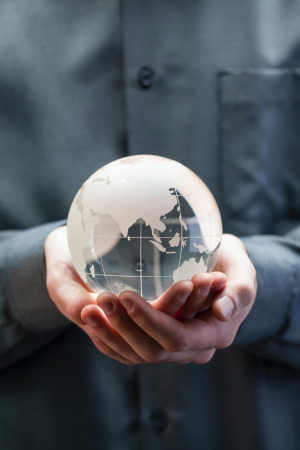 Hands+holding+glass+globe