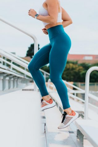 Close up of woman running up stadium steps