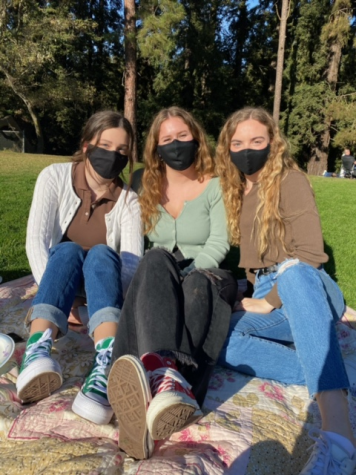 Three masked female students