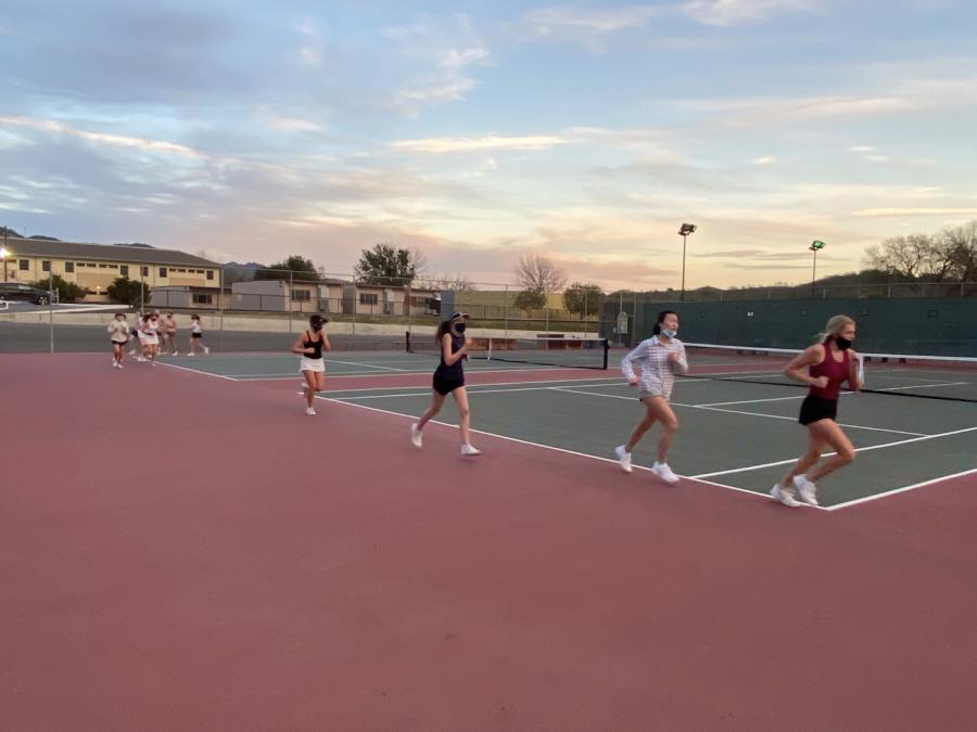 High+school+tennis+athletes+running+on+track