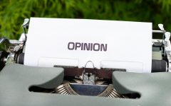 Sign that says opinion on white card