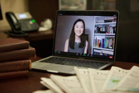 Photo of Su on computer screen